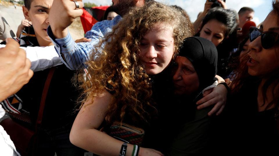 Palestinian teenager Ahed Tamimi is welcomed by relatives and supporters after she was released from an Israeli prison, at Nabi Saleh village in the occupied West Bank. (Mohamad Torokman / REUTERS)