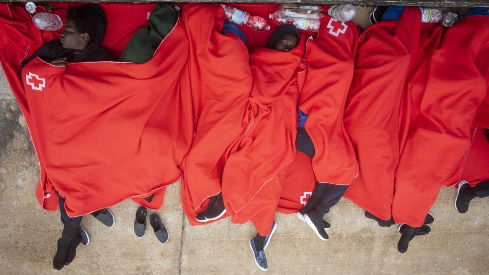 With police stations and makeshift emergency shelters set up in sports centres in Cadiz full, many rescued migrants were forced to sleep inside an orange rescue boat docked in the port of Algeciras, or on the pavement beside it. (Marcos Moreno / AP)