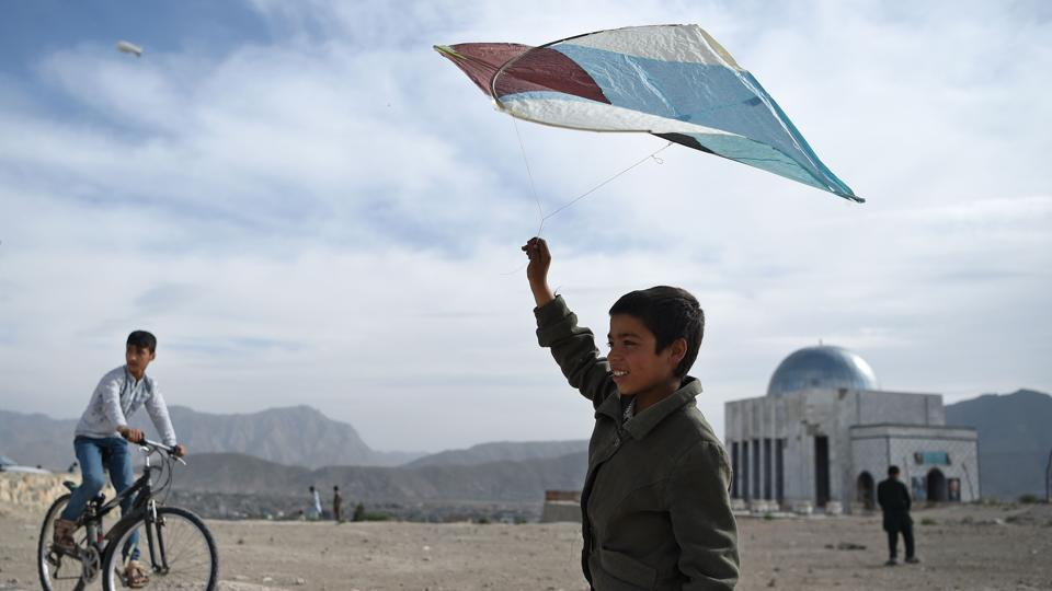An Afghan boy prepares to fly a kite during a kite battle on a hillside in Kabul. After selling hundreds of thousands of kites during the cooler months, particularly in spring when flying conditions are ideal, kite makers spend the rest of the year replenishing their stocks. (Wkil Kohsar / AFP)