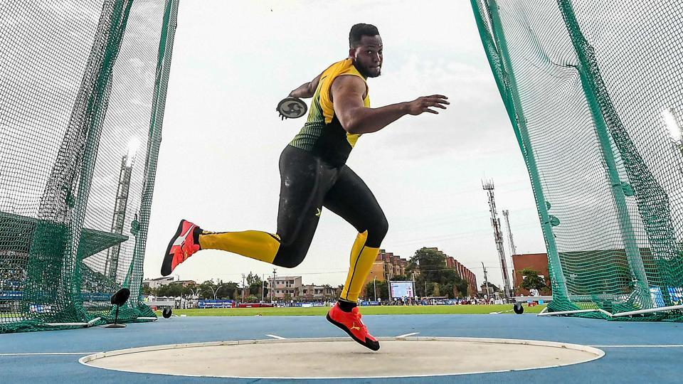 Jamaica's Travis Smikle competes in the Men's Disc Throw final event during the 2018 Central American and Caribbean Games (CAC), in Barranquilla, Colombia. (Luis Acosta / AFP)
