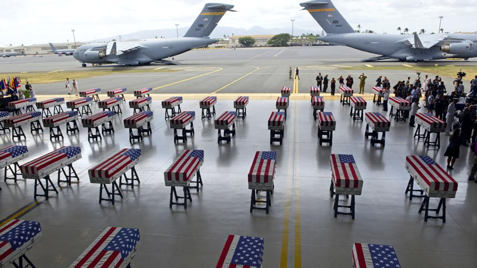 Flag draped transfer cases with the remains of American soldiers repatriated from North Korea are seen during a repatriation ceremony after arriving to Joint Base Pearl Harbor-Hickam, Honolulu, Hawaii. (Ronen Zilberman / AFP)