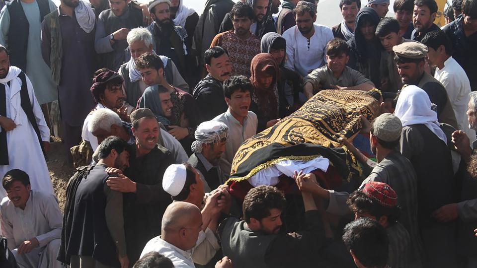 Afghan Shiite mourners carry a coffin during a burial ceremony for the 35 victims of a suicide attack in a Shiite mosque in Gardez of Paktia province on August 4, 2018.