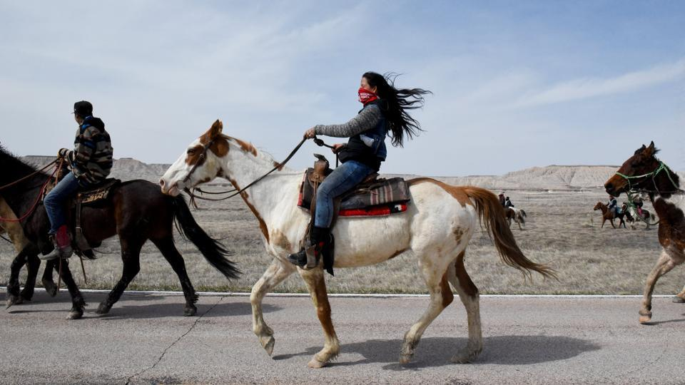 Stephanie Big-Eagle rides with other treaty riders on the Pine Ridge Reservation in South Dakota. In 2018, to mark the 150th anniversary of the Fort Laramie peace treaty between the Sioux Nation and US government, the Lakota (Sioux) people embarked on a 640 km ride from Green Grass, South Dakota, home to their spiritual leader, Arvol Lookinghorse to Fort Laramie, Wyoming. (Stephanie Keith / REUTERS)