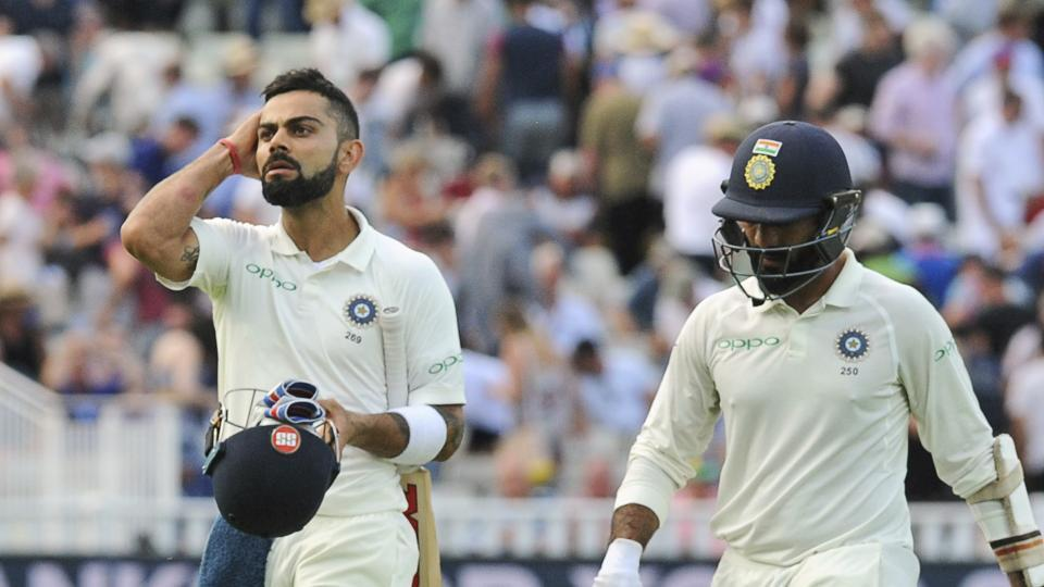 India captain Virat Kohli, left, and Dinesh Karthik will look to take India as deep as possible in their chase of 194 against England at Edgbaston. (AP)