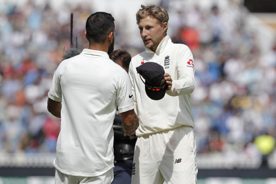England's captain Joe Root (R) shakes hands with India's captain Virat Kohli after the game ends on the fourth day of the first Test cricket match between England and India at Edgbaston in Birmingham, central England on August 4, 2018.