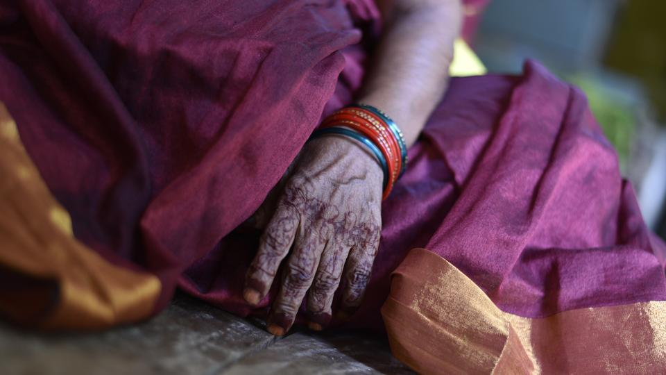 A detail of mehndi applied to hand of Saraswati Aggarwal who came to live in Mumukshu Bhavan. The stay at Mukti Bhavan is free. The visitor must have an attendant, and can take a room for a maximum of 15 days, after which Shukla decides whether to extend the stay or not depending on the person's health and the availability of rooms. Other facilities meant for moksharthis have different terms and conditions. (Sanchit Khanna / HT Photo)