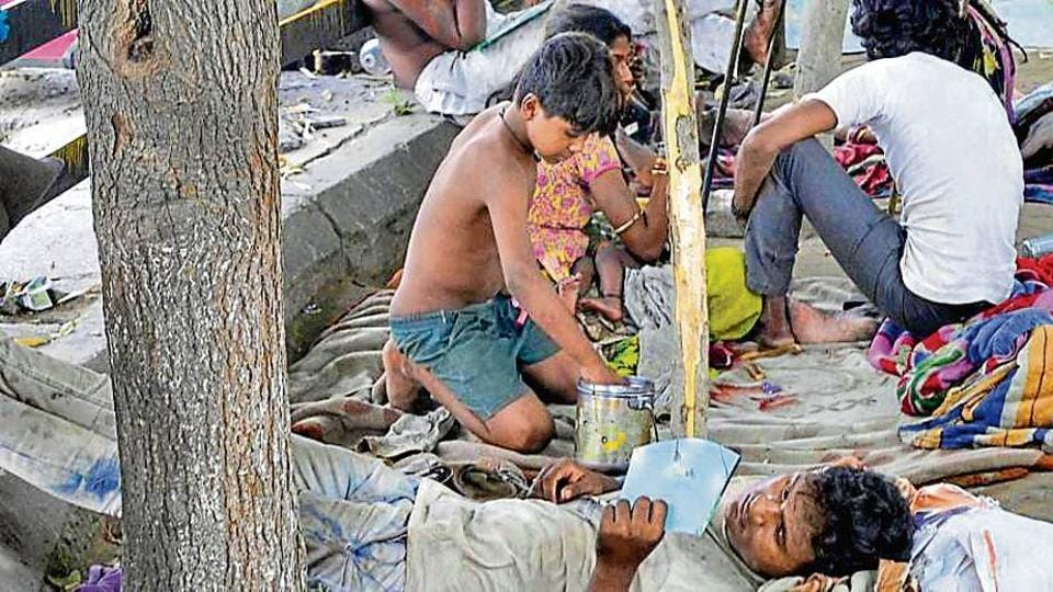 Few days ago, a group of seven families, comprising 10 adults and as many as 15 children, from Chittorgarh (Rajasthan), came to the city and encroached on a part of footpath near Bhai Bala Chowk.