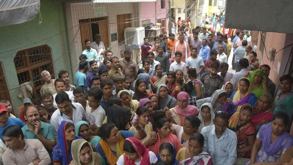 Residents of the locality outside  the house of the  five-year-old victim in Khoda,  Ghaziabad on August 4, 2018.