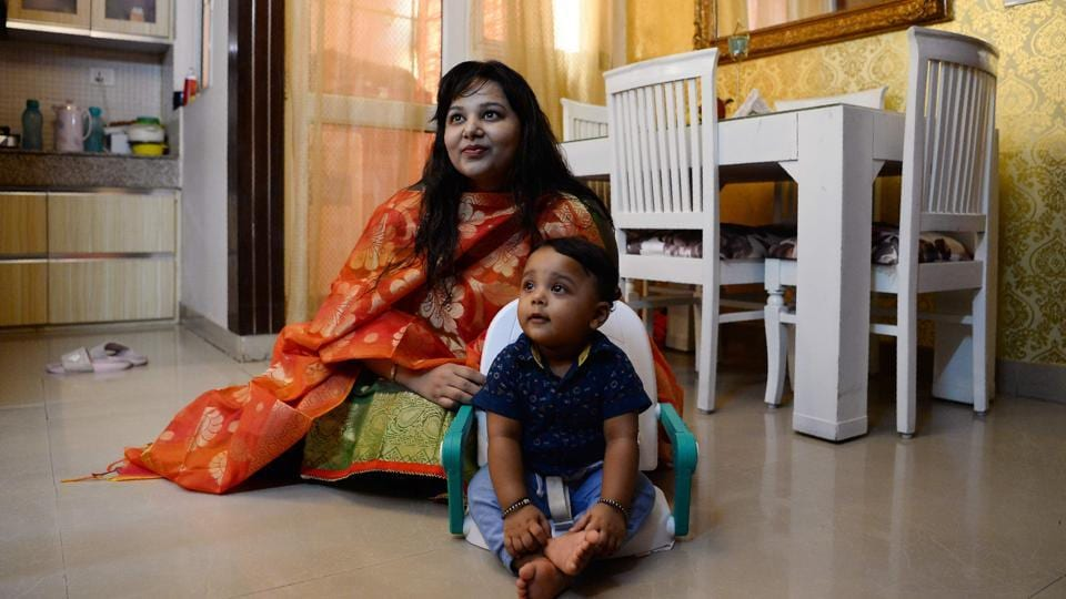 Neha Rastogi with her nine-month-old son Avyaan during an interview at their residence in Noida. Clutching a toy, Avyaan's conversation is pretty much limited to a happy gurgle, but the nine-month-old might be about to go down in history for helping make breastfeeding in public more socially acceptable in India. (Sajjad Hussain / AFP)