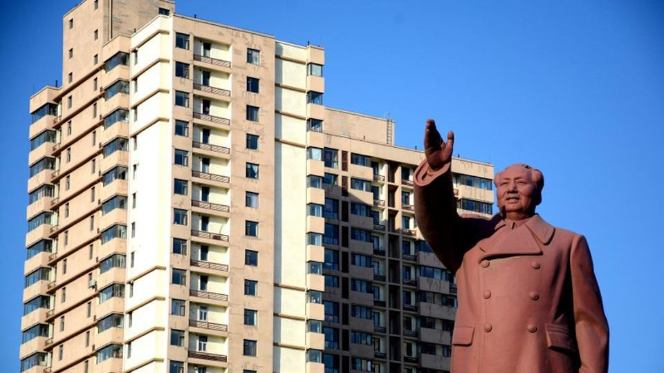 A statue of former Chinese chairman Mao Zedong is seen in front of a residential building in Dandong New Zone, Liaoning province, China on June 12, 2018.