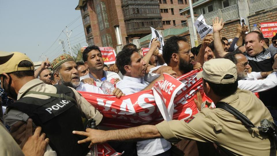 Traders shout slogans during a march on the second day of shutdown to protest against challenging Article 35A at Lal Chowk, Srinagar. The Supreme Court on Monday adjourned the hearing of petitions challenging the validity of Article 35A, which allows special rights to permanent residents of Jammu and Kashmir, amid a statewide shutdown declared by Kashmiri separatists and a number of organisations. The top court said it will hear the petitions from August 27. (Waseem Andrabi / HT Photo)