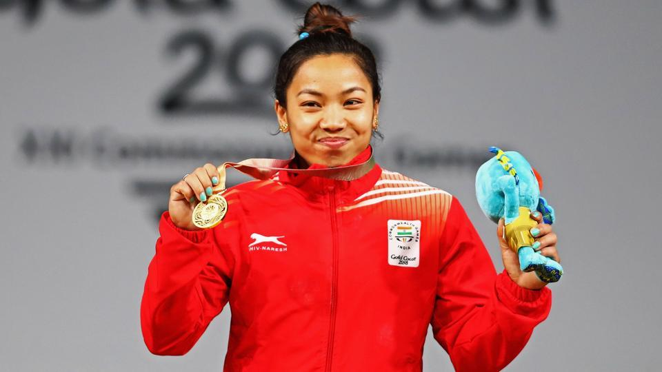 Mirabai Chanu celebrates on the podium after the Weightlifting Women's 48kg Final at the 2018 Commonwealth Games.