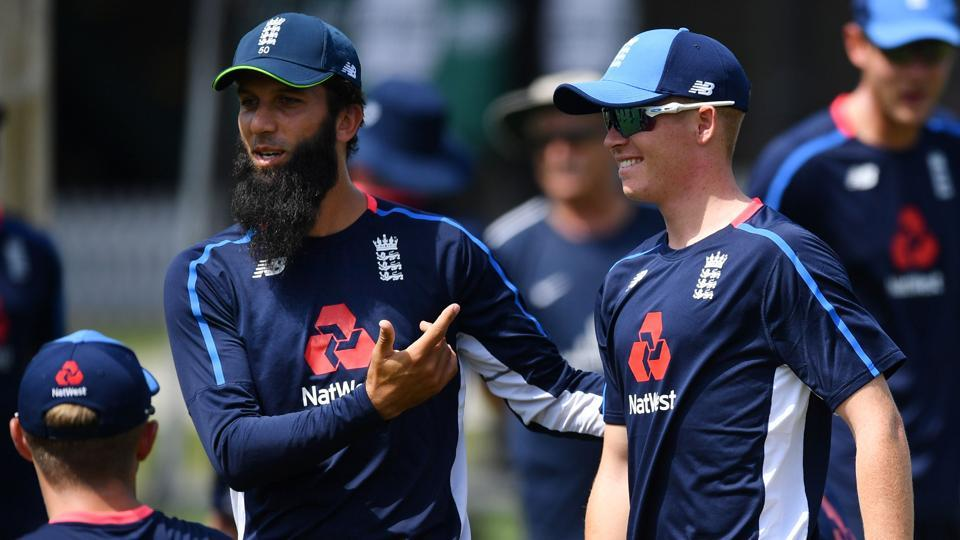 England's Moeen Ali (L) embraces Ollie Pope (R) during a training session. (AFP)