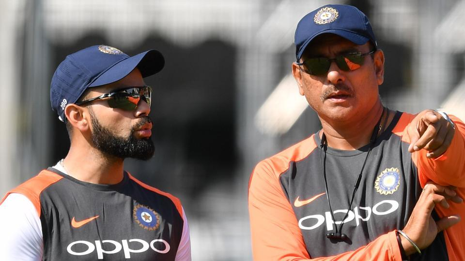 India's captain Virat Kohli (L) talks with India's head coach Ravi Shastri (R) during a practice session. (AFP)