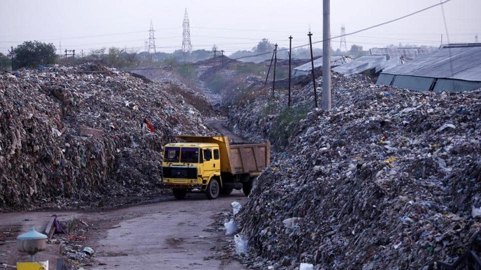 "The Supreme Court on Monday said that Delhi was facing an ""emergency situation"" due to mountains of garbage as it expressed dissatisfaction over the response of authorities on waste management. The court fumed and said that people have every right to question the decision and even went on to say that the civic body should dump the ""waste on the Raj Niwas Marg"", where Delhi lieutenant governor's official residence is located. (Adnan Abidi / REUTERS File)"