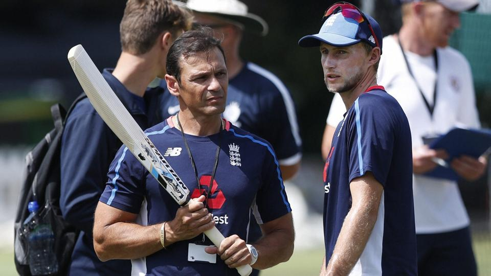 England's batting coach Mark Ramprakash, talks to the England team captain Joe Root. (AP)