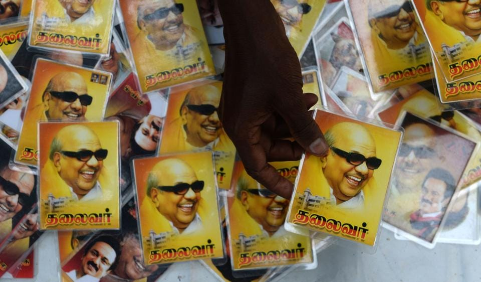 A vendor displays portraits of Dravida Munnetra Kazhagam (DMK) party president M.Karunanidhi in front of the hospital where Karunanidhi was being treated.