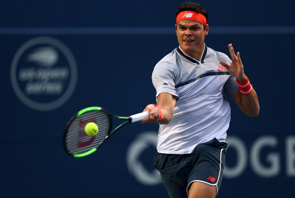 Milos Raonic of Canada plays a shot against David Goffin of Belgium during a 1st round match on Day 1 of the Rogers Cup at Aviva Centre on August 6, 2018 in Toronto, Canada.