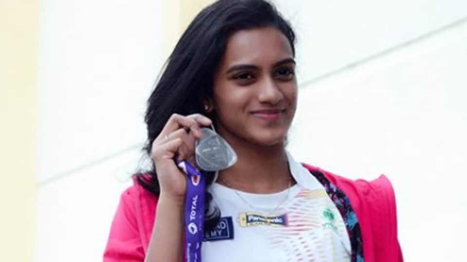 PVSindhu clinched silver at the Badminton World Championships.
