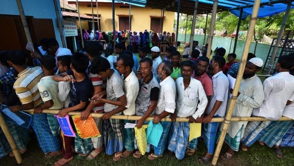 People wait in queue to check their names on the draft list at the National Register of Citizens (NRC) centre at a village in Nagaon district, Assam.