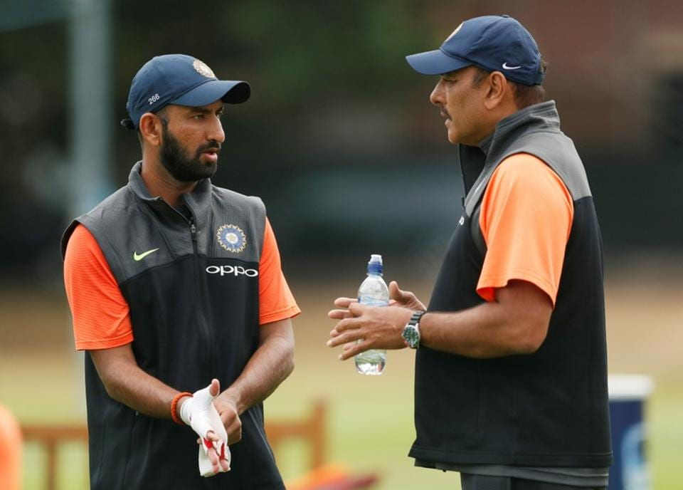 Cheteshwar Pujara in a conversation with coach Ravi Shastri (Action Images via Reuters)