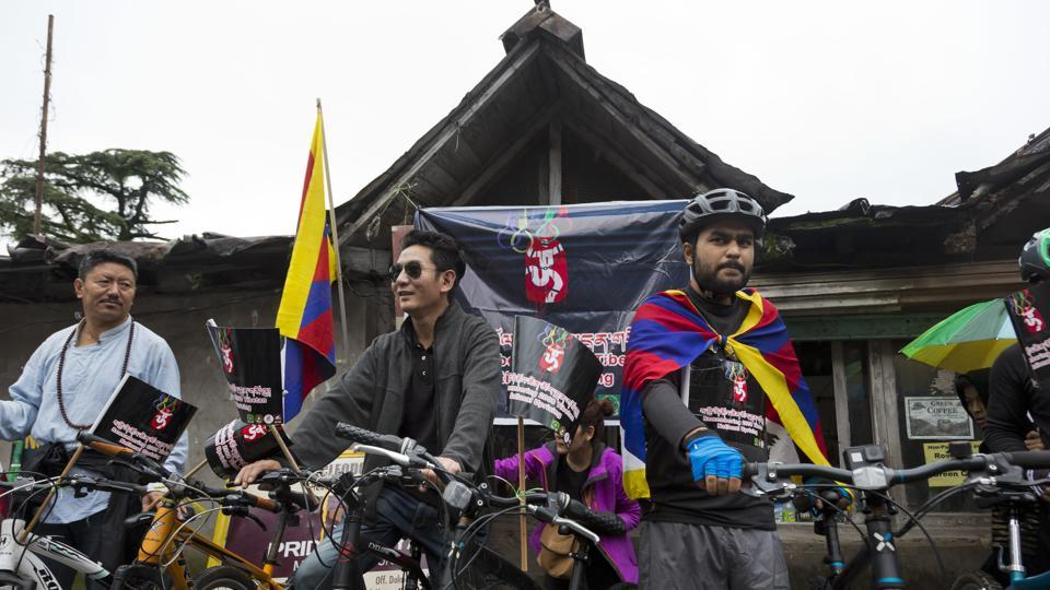Exile Tibetans get ready for a cycle rally to commemorate the 2008 uprising in Tibet, ten years after the inauguration of the Beijing Olympics, in Dharmsala. Beginning in March 2008, hundreds of Tibetans had taken to streets in the Tibetan capital Lhasa protesting Chinese rule. (Ashwini Bhatia / AP)