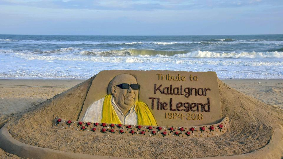A sand art, created by the sand artist Sudarshan Patnaik to pay tribute to DMK chief M Karunanidhi, at Puri beach. (PTI Photo)
