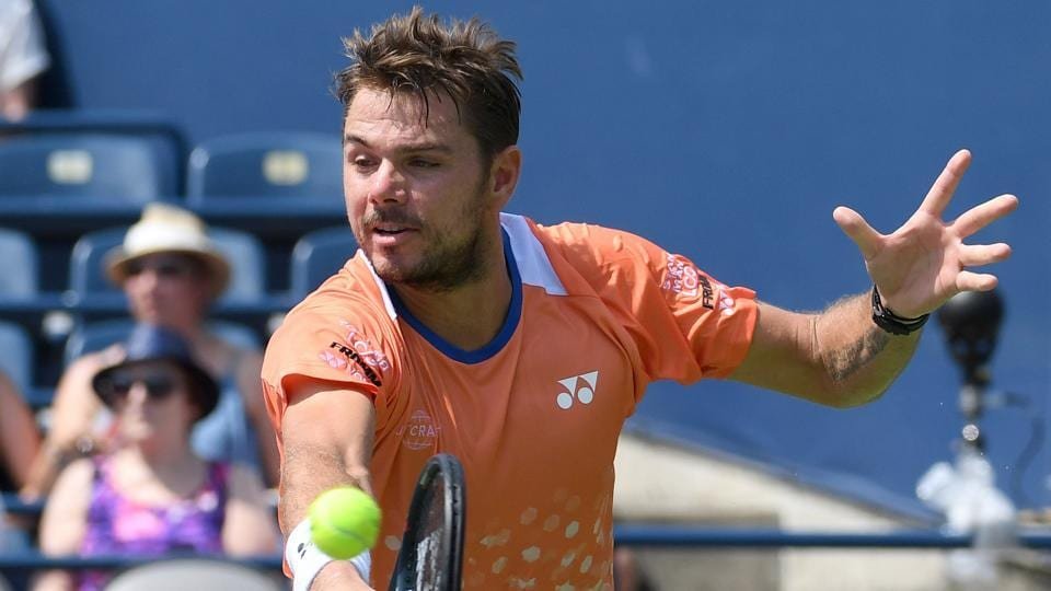 Stan Wawrinka of Switzerland plays a shot against Nick Kyrgios of Australia (not shown) in the Rogers Cup tennis tournament.