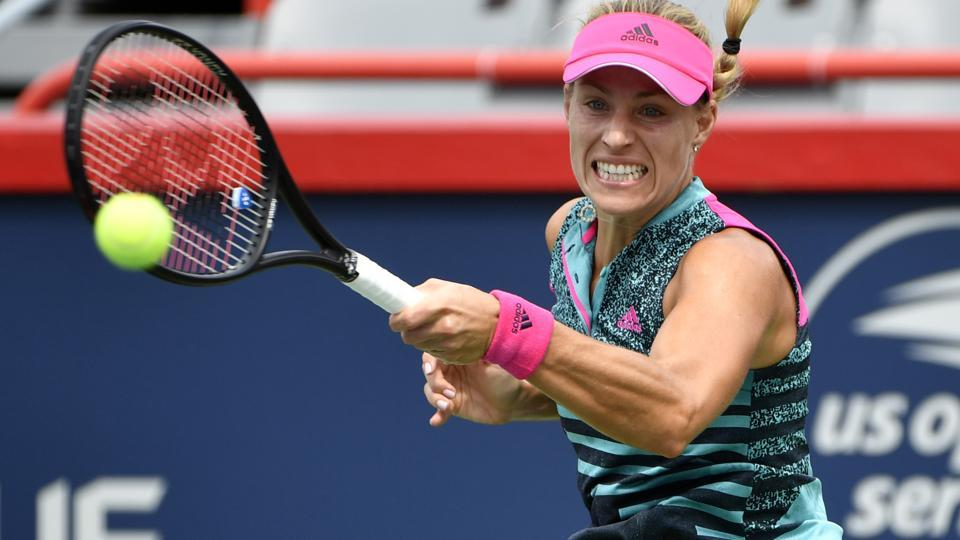 Angelique Kerber of Germany hits a forehand against Alize Cornet of France (not pictured).