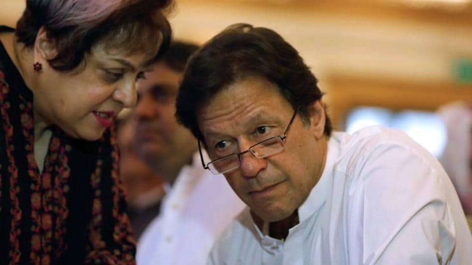 Imran Khan, chairman of the Pakistan Tehreek-e-Insaf (PTI), listens to his lawmaker Shireen Mazari during unveiling party's manifesto for the upcoming general election, in Islamabad, Pakistan July 9, 2018.