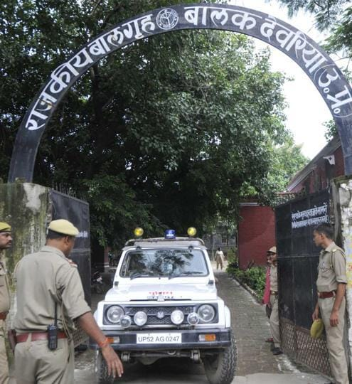 Police officials taking the resued girls for recording their statements in the court in Deoria.