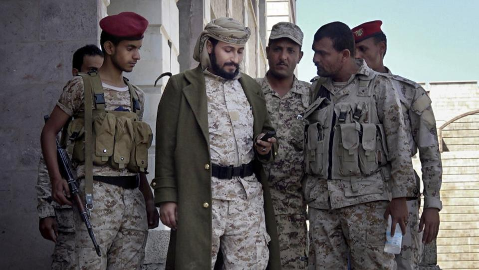 """There is no filtering in the war. We are all together,"" said one activist. Abdel-Sattar al-Shamiri, a former adviser to Taiz's governor, recognized al-Qaida presence from the start and told commanders not to recruit members. Their response was, 'We will unite with the devil in the face of Houthis.' One of the main recruiters of al-Qaida fighters is Adnan Rouzek (C), tapped by President Hadi to be a top military commander. (AP)"