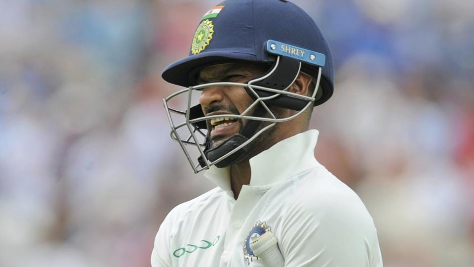India's Shikhar Dhawan reacts after being dismissed during the third day of the first test cricket match between England and India at Edgbaston.