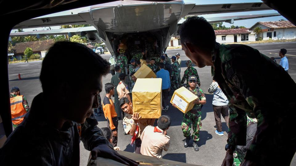 Indonesian soldiers unload relief aid for earthquake victims from a plane at an airbase in Mataram, Lombok, Indonesia August 9.