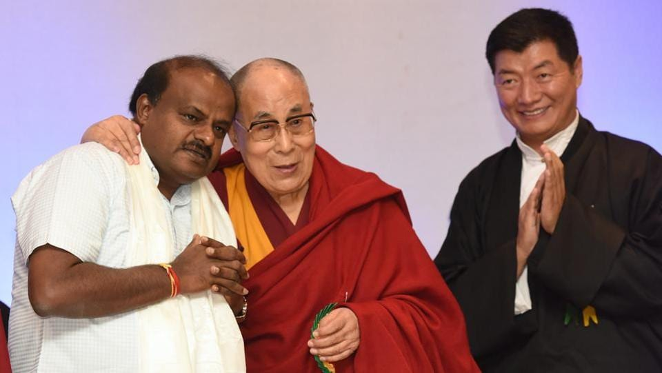 Tibetan spiritual leader Dalai Lama poses for photographs along with chief minister of Karnataka, H D Kumarswamy as Dr Lobsang Sangye, the President of Central Tibetan Administration, Dharmashala looks on during the celebration of  'Thank You Karnataka Day', organised by Tibetans living in Karnataka, at Taj West End, in Bengaluru. (Arijit Sen / HT Photo)