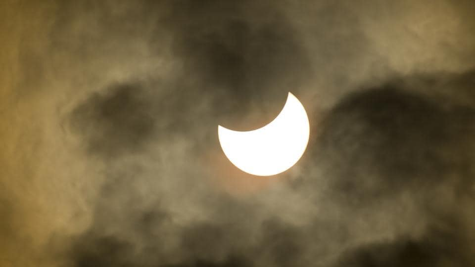 A partial solar eclipse takes place when the earth moves through the lunar penumbra as the moon travels between the earth and the sun. This is the partial solar eclipse viewed under cloudy skies from Arizona on August 21, 2017.