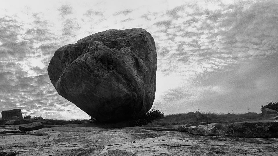 A large boulder sits amid the ruins in Hampi. The Hasselblad palette of these exquisite black and white photographs is made up of visual octaves through the many subtle shades that lie between black and white, stillness and movement. (Rajib De)