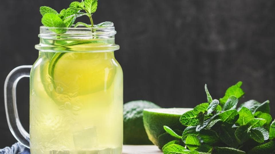Drop lemon slices, mint leaves and cucumber into a jar of ice cold water and drink up. An excellent way to feel refreshed.  (shutterstock)
