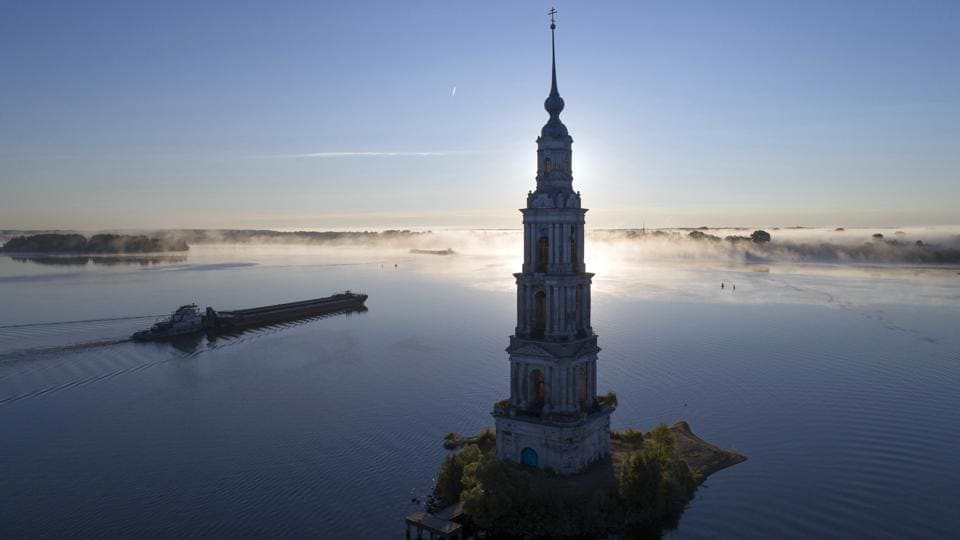 A cargo ship floats past the famous Kalyazin Bell Tower, part of the submerged monastery of St. Nicholas, in the town of Kalyazin located on the Volga River, north-east of Moscow, Russia. (Dmitry Lovetsky / AP)