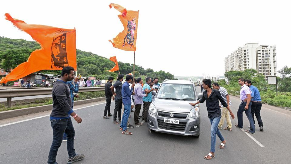 Protesters took law into their own hands near Chandani Chowk area on Pune-Bengaluru highway as they jumped in front of cars and other vehicles, threatening them to go back or face 'dire consequences'. (Pratham Gokhale/HT Photo)