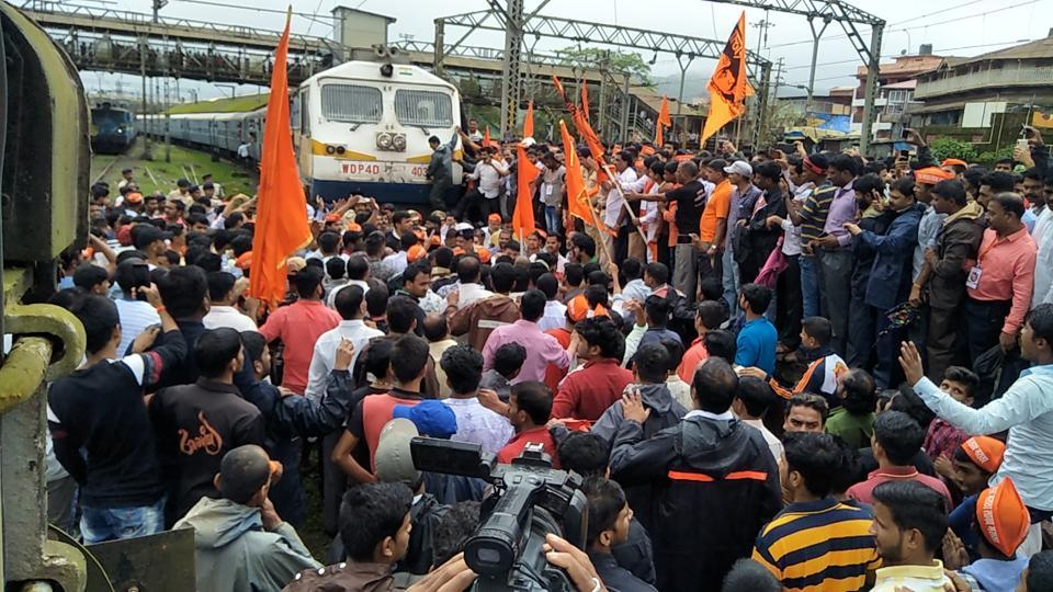 At Lonavla, protestors took the agitation further and organised a rail roko protest on Thursday. Commuters were stranded as several trains were delayed. (HT Photo)
