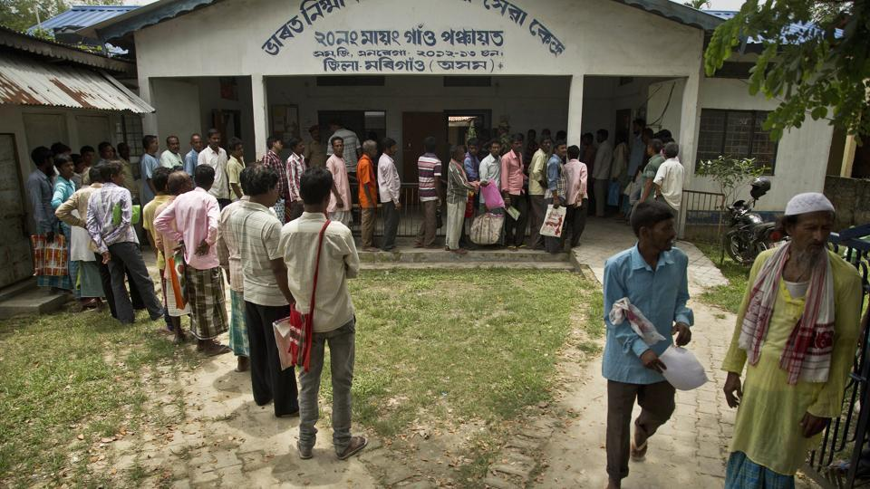 People whose name were left out in the National Register of Citizens draft stand in a queue to collect forms to file appeals in Mayong, 45 kilometers east of Guwahati, on Friday.