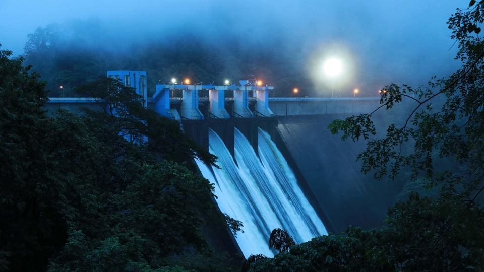 Water gushes out of Idamalayar dam as shutters of the dam opened with the storage level crossing 169 metre, the full reservoir level near Bhoothathankettu, on the Idamalayar River, a tributary of the Periyar River.