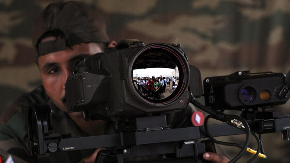 Army personnel showing the use of thermal imaging device which is used for night vision.  (NITIN KANOTRA/HT)