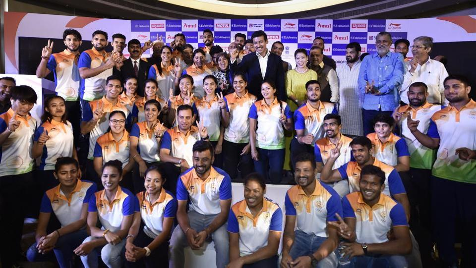 Sports Minister Rajyavardhan Singh Rathore stands for a group photograph with the Indian contingent for the Asian Games 2018, during their send-off ceremony in New Delhi. (Ravi Choudhary / PTI)