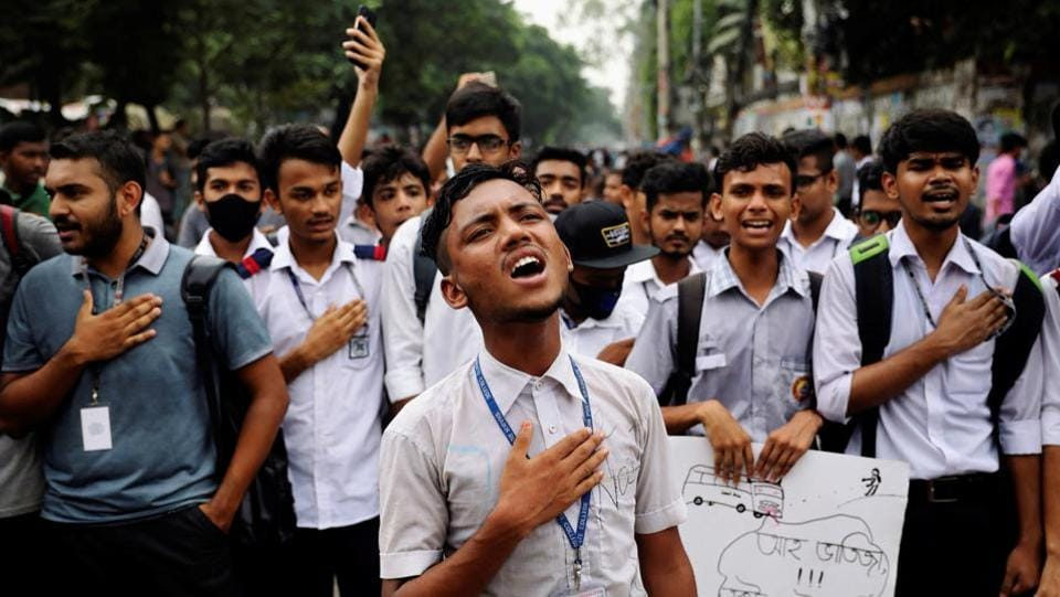 Students sing the national anthem as they take part in a protest over recent traffic accidents that killed a boy and a girl, in Dhaka, Bangladesh. (Mohammad Ponir Hossain / REUTERS)