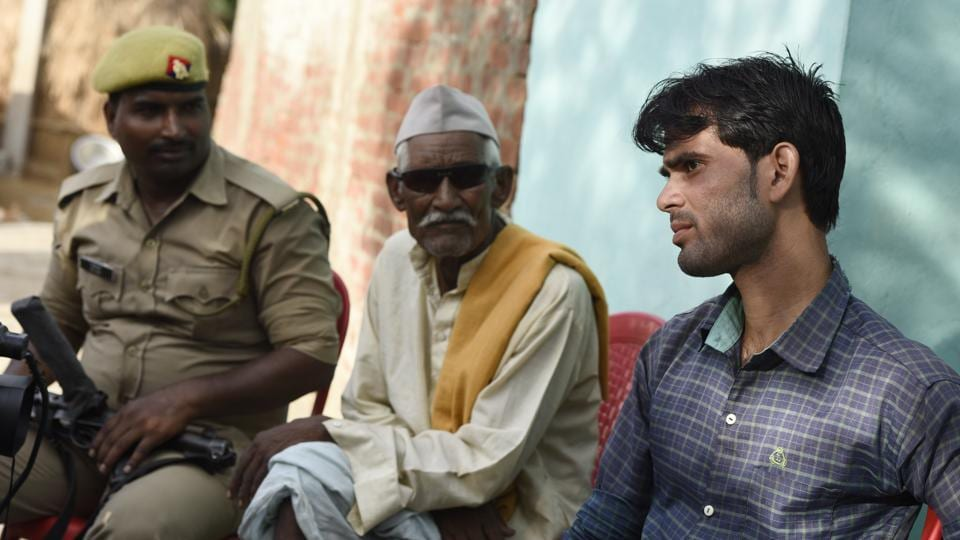 "Beetu Kumar Jatav (R), The bride's brother speaks to reporters. ""We have been told that the price of this baraat will be heavy. We have to live in the village. We hope nothing bad happens. The Thakurs are not happy,"" Jatav said. The wedding etched a landmark because Sanjay refused to back down in a scenario that has frequently triggered boycotts or bloodshed in the region. (Burhaan Kinu / HT Photo)"