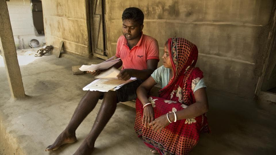 Pranab Mandal and his mother review their documents after being left out from the draft. Proving residency can be complicated in a region where basic paperwork has only recently become commonplace in many villages. State officials insist they have done everything to make the procedure fair. The citizenship project involves 52,000 officials, visits to 6.8 million families and countless hearings to examine family trees. (Anupam Nath / AP)