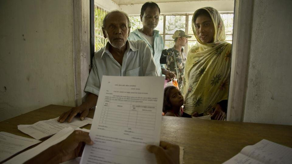 People whose names were left out in the National Register of Citizens (NRC) draft stand to collect forms to file appeals in Mayong. Nearly 4 million people who insist they are Indian must now prove their nationality as the politics of citizenship — overlaid with questions of religion, ethnicity and illegal immigration — swirls in a state where such questions have a long and bloody past. (Anupam Nath / AP)