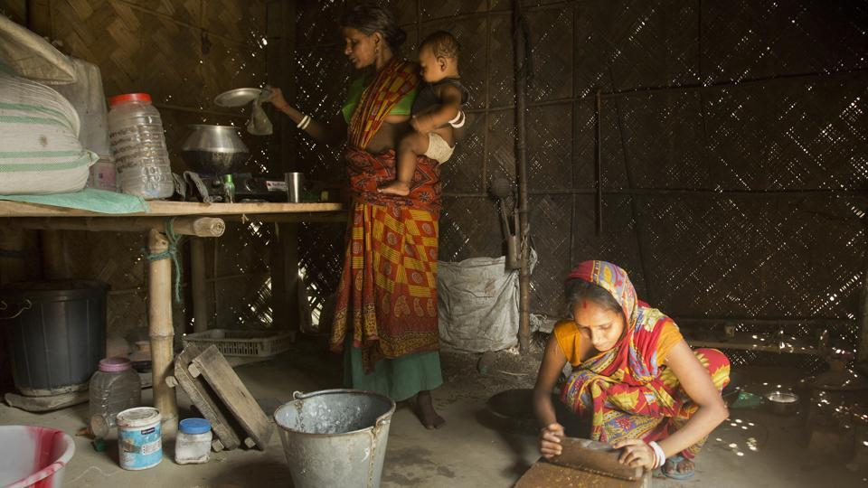 Pratima Namo Das, 22, (R) and her mother-in-law Tara Namo Das, 45, cook inside the family house in Mayong. It's unclear what will happen to people who are still not listed as citizens after appeals. Detention is a strong possibility for some, but Bangladesh insists it will not accept mass expulsions. Activists worry many could be left in limbo for years, perhaps decades as stateless wanderers. (Anupam Nath / AP)